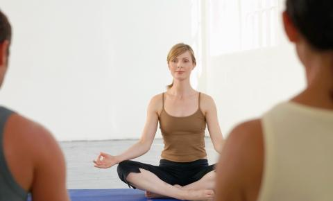 Classical yoga instructor conducts a class.