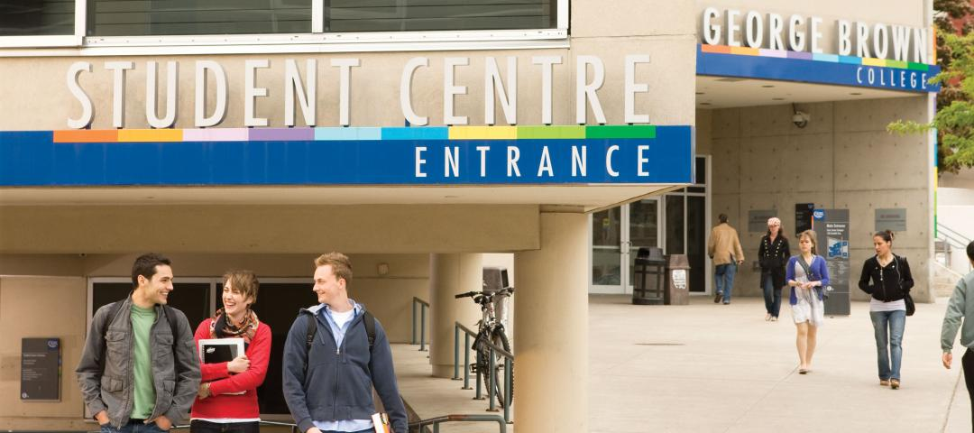 Students stand in front of a Student Service Centre.