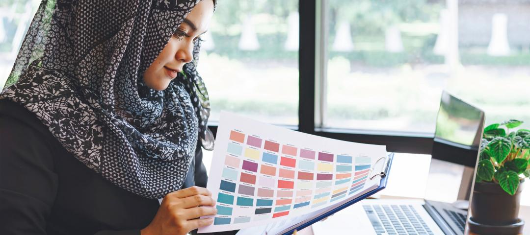 Designer reviews the palette of a colour swatch while at work.