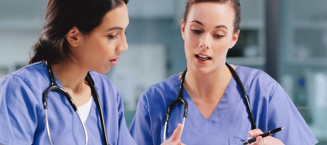 Nurses have a in-depth conversation about a patients chart.