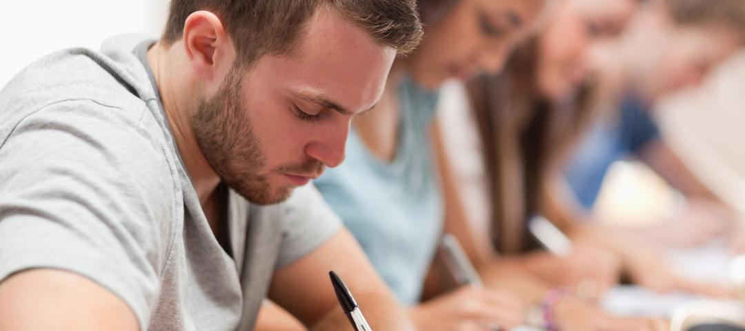 Students busily writing during an exam.