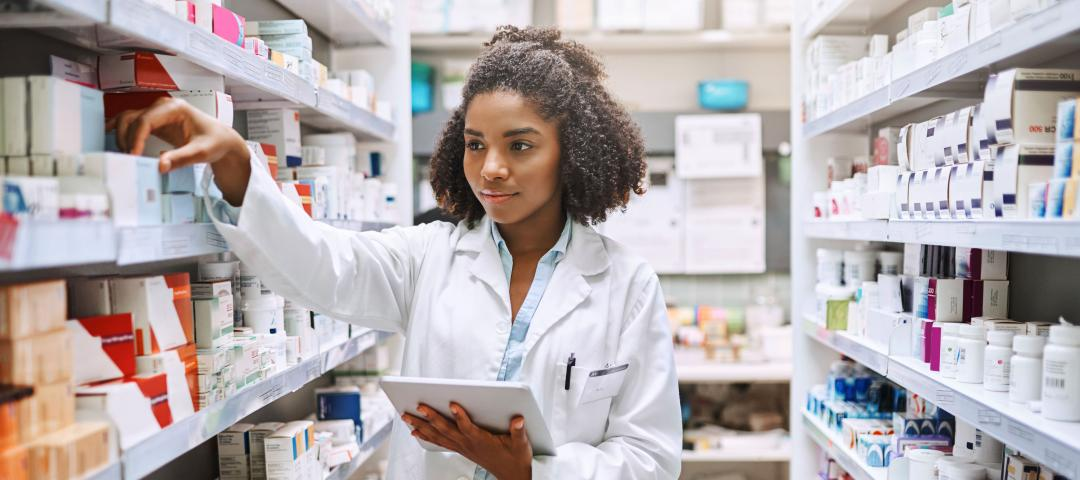 Pharmacy assistant checks inventory at a pharmacy.